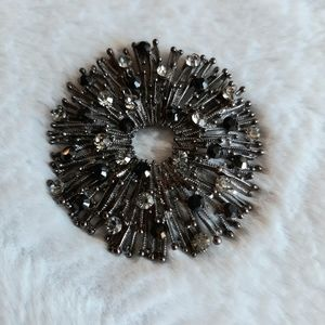 Vintage silver and black brooch